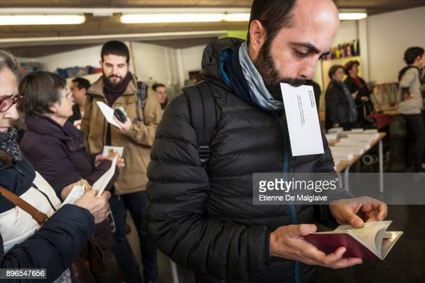 Voters wait to cast their ballot for the Catalan regional election at Fort Pienc school polling station on December 21 2017 in Barcelona Spain...