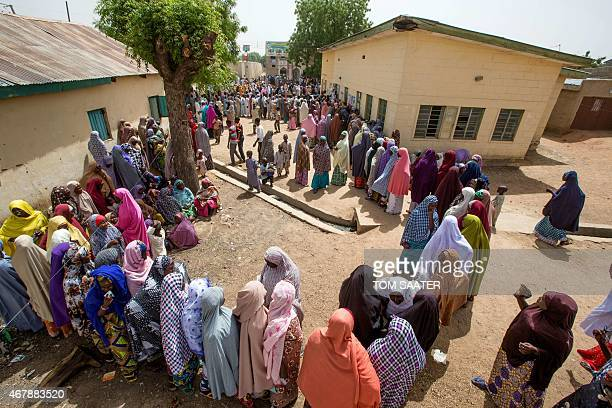 Voters wait to cast their ballots at a polling station on the outskirt of Kano during the presidential elections on March 28 2015 Voting began in...