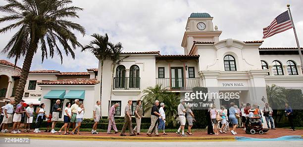 Voters wait to cast their ballots outside a polling place in Palm Beach County November 2, 2004 in West Palm Beach, Florida. Polls showed President...
