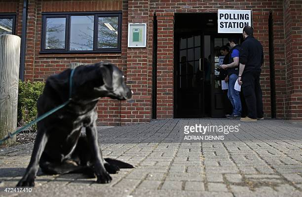 Voters wait to cast their votes at a polling station in Elvetham Heath in southern England on May 7 as Britain holds a general election Polls opened...