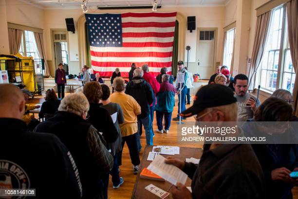 Voters wait to get a ballot at a polling station during the mid-term elections at the Old Stone School in Hillsboro, Virginia on November 6, 2018. -...