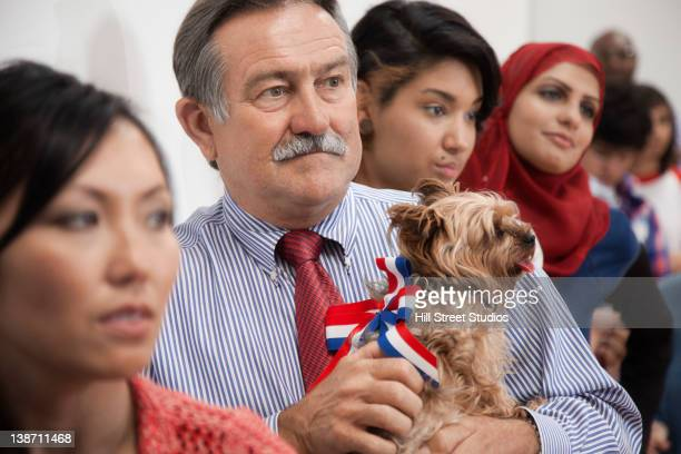 voters waiting to vote in polling place - dog knotted in woman stock pictures, royalty-free photos & images