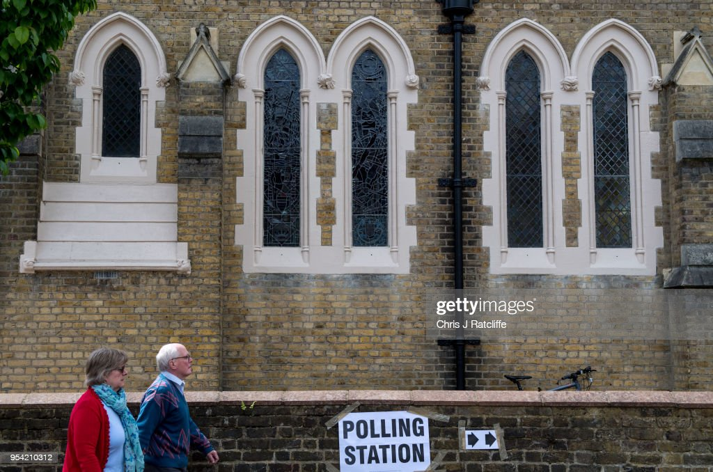 Voters walk into polling station in a church in Twickenham as voters go to the polls in the English local council elections on May 3, 2018 in London, England. Votes are being cast in more than 4,300 council areas in the biggest test for the political parties since the general election last year.