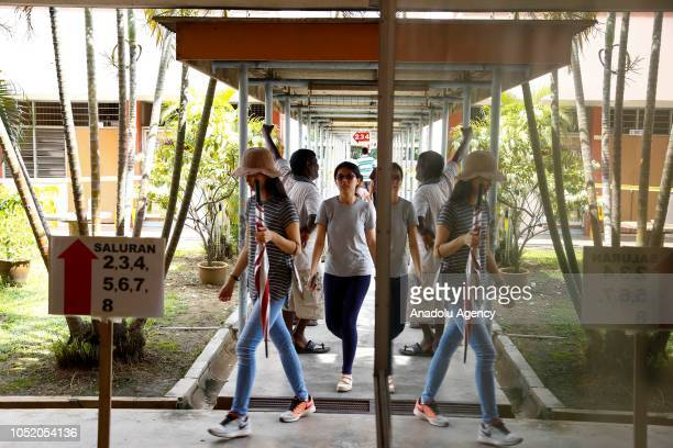 Voters walk to the polling station during the Port Dickson byelection on October 13 2018 in Port Dickson Malaysia The Port Dickson seat was vacated...