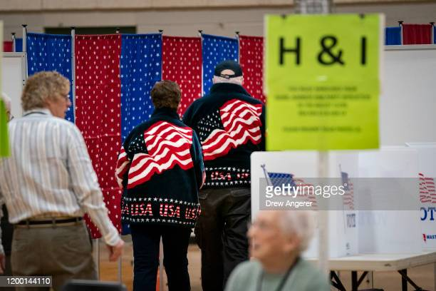 Voters walk to voting booths at a polling station at David R Cawley Middle School on February 11 2020 in Hookset New Hampshire New Hampshire holds...
