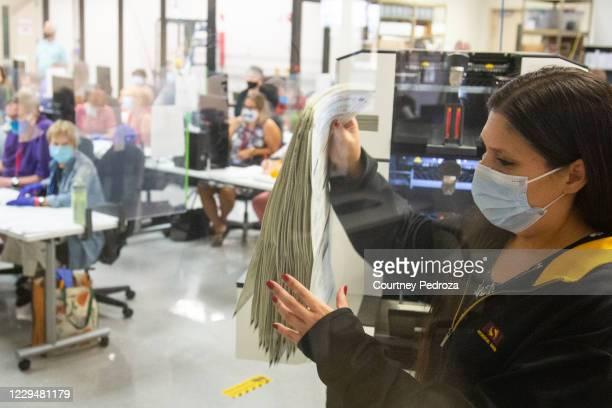 Votes are counted by staff at the Maricopa County Elections Department office on November 5, 2020 in Phoenix, Arizona. Ballots continue to be counted...