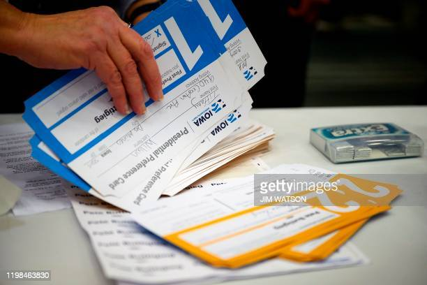 Votes are counted during caucusing in the 66th precinct at Abraham Lincoln High School in Des Moines Iowa on February 3 2020