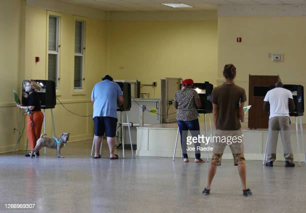 Votes fill out their ballots on primary election day on August 18, 2020 in Miami, Florida. Voters are casting ballots in Miami-Dade to elect...