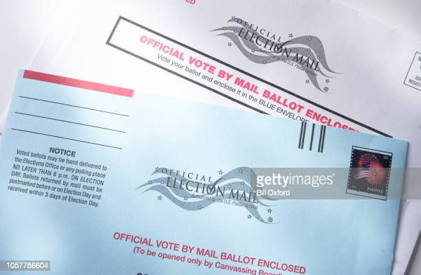 voting ballot: absentee voting by mail with ballot envelope - absentee ballot stock pictures, royalty-free photos & images