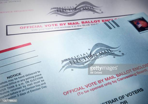 voting ballot: absentee voting by mail with ballot envelope - mail stock pictures, royalty-free photos & images