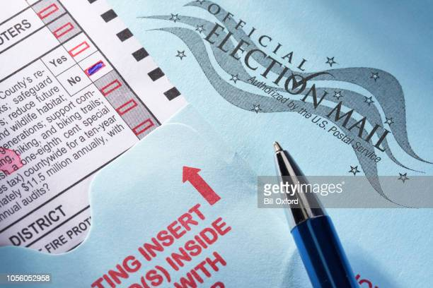 voting ballot: absentee voting by mail with candidates and measures - absentee ballot stock pictures, royalty-free photos & images