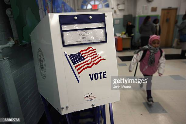 A voting booth stands at the ready as students return to school on November 5 2012 in the East Village neighborhood of New York United States...