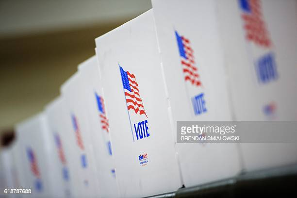 Voting booths are seen at the Potomac Community Recreation Center during early voting on October 28 2016 in Potomac Maryland / AFP / Brendan...