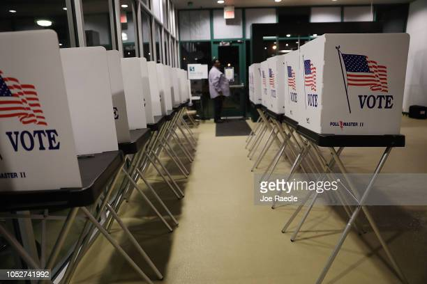 Voting booths are setup at the Yuengling center on the campus of University of South Florida as workers prepare to open the doors to early voters on...
