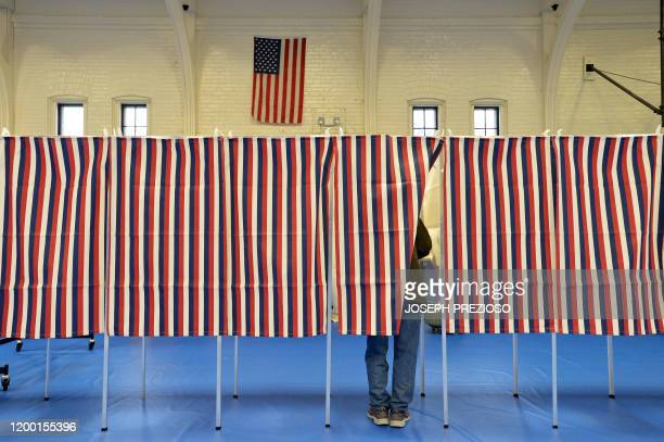 TOPSHOT Voting booths filled the the Ward Five Community Center during the New Hampshire primary in Concord New Hampshire on February 11 2020...