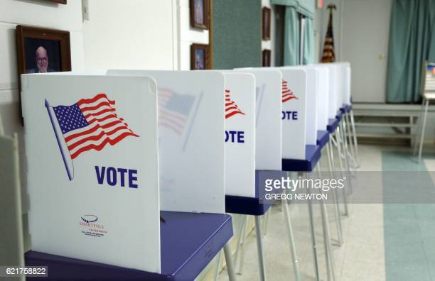 Voting booths set up and ready to receive voters inside a polling station in Christmas Florida on November 8 2016 After an exhausting wild bitter and...
