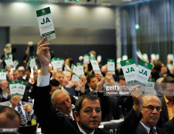 Voting cards are held in the air during the German Football Association Bundestag at the Steigenberger Airport Hotel on April 9 2010 in Mainz Germany