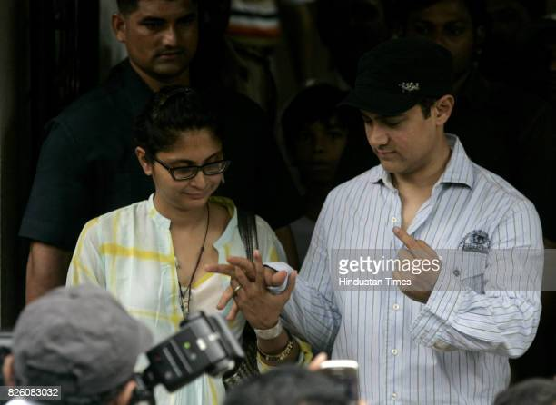 Voting Elections Maharashtra Assembly Polls 2009 Bollywood celebrity Aamir Khan with his wife Kiran Rao voted at St Annies school in Bandra on...