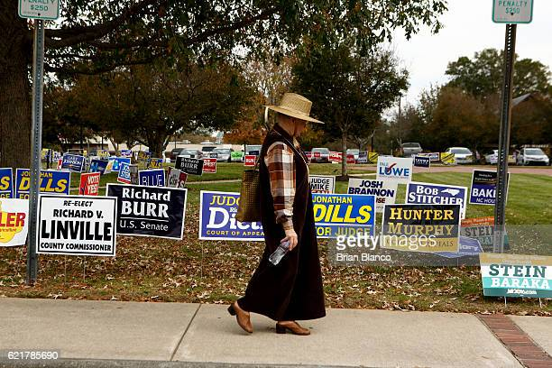 Voting for the first time since 1982 June Fournier walks by a collection of campaign signs as she exits the Paddison Memorial Library polling place...