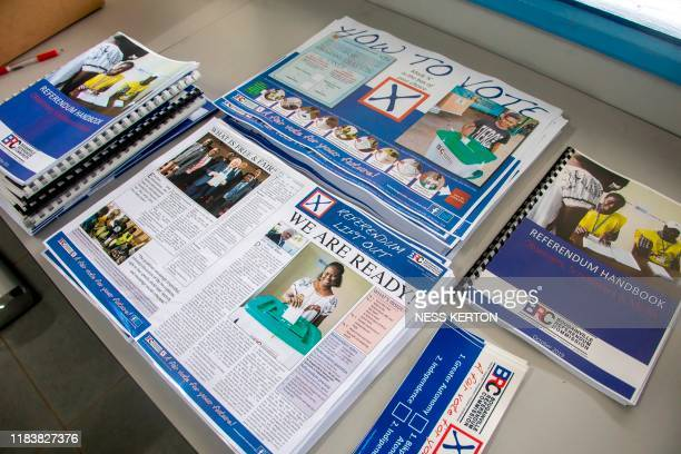 Voting information pamphlets are seen at a polling station ahead of an historical independence vote in the capital Buka on November 22 2019 The...