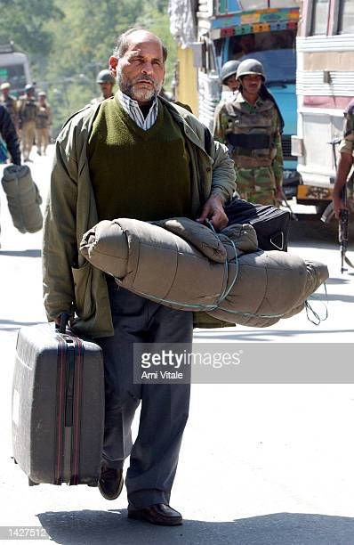 A voting official arrives at a polling station wearing a bullet proof vest in preparation for tomorrows voting September 23 2002 in Badgam in the...
