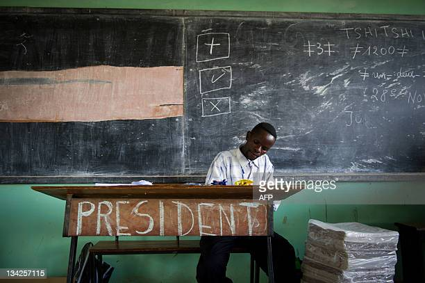 A voting official sits in the Njanja polling station in Lubumbashi on November 29 2011 Monitors reported widespread fraud in Democratic Republic of...