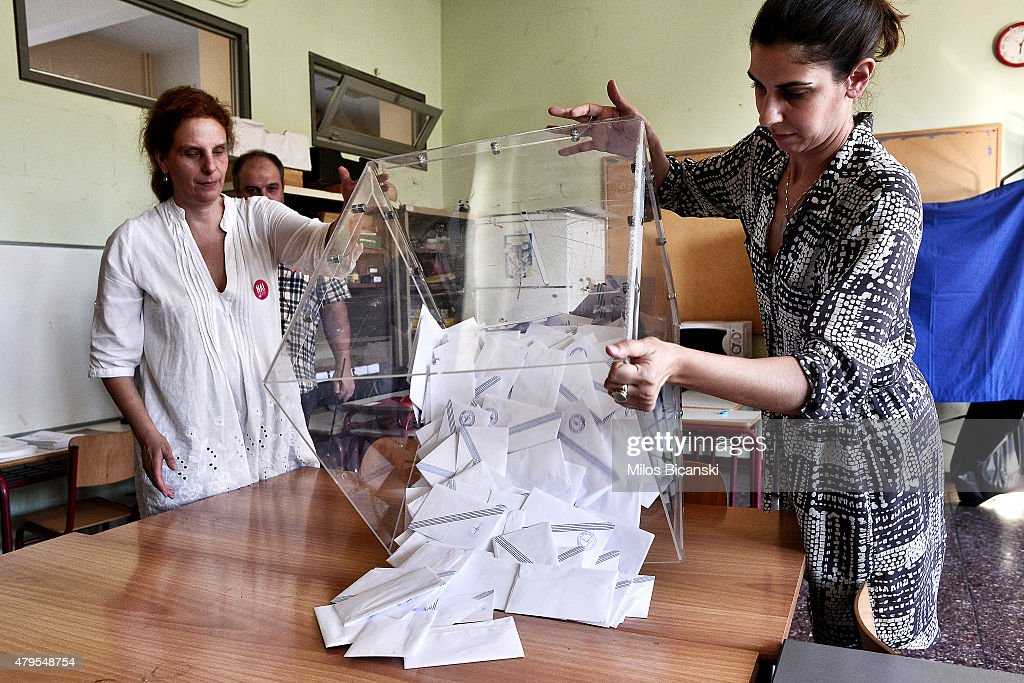 Voting officials count votes after polls are closed in Athens on July 5, 2015 in Athens, Greece. The people of Greece are going to the polls to decide if the country should accept the terms and conditions of a bailout with its creditors. Greek Prime Minister Alexis Tsipras is urging people to vote 'a proud no' to European creditors' proposals, and 'live with dignity in Europe'. 'Yes' campaigners believe that a no vote would mean financial ruin for Greece and the loss of the Euro currency.