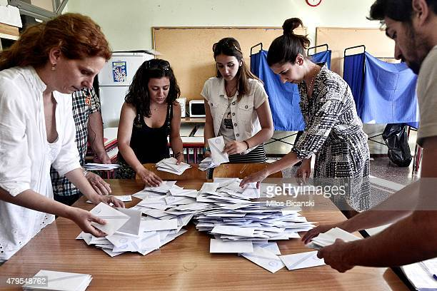 Voting officials count votes after polls are closed in Athens on July 5 2015 in Athens Greece The people of Greece are going to the polls to decide...