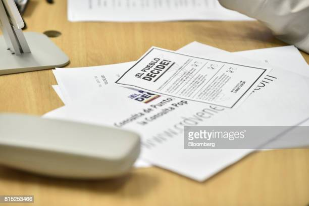 Voting papers sit on a table as Henrique Capriles opposition leader and governor of the State of Miranda not pictured speaks during a press...