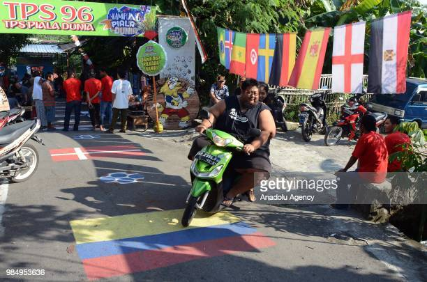 A voting place is being decorated with World Cup theme in Surakarta region of Central Java on June 27 2018 Creativity of citizens decorate voting...