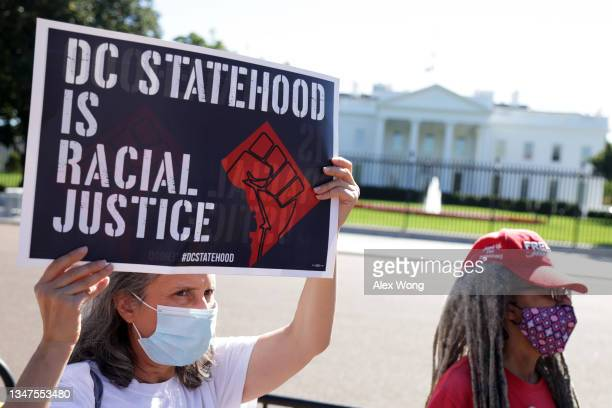 """Voting rights activists gather for a rally outside the White House October 19, 2021 in Washington, DC. People of American Way held a rally on """"No..."""