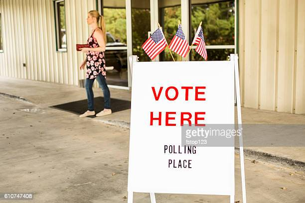 voting sign outside local polling station during american november elections. - presidential election stock pictures, royalty-free photos & images