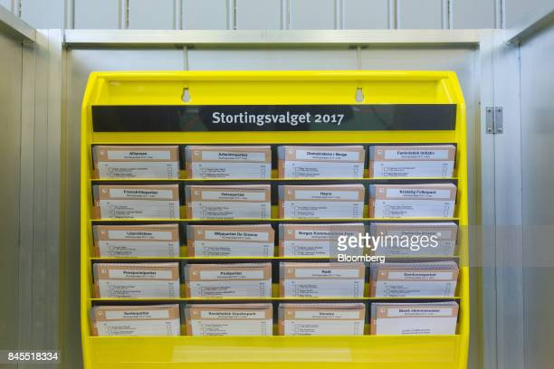 Voting slips for different political parties sit in a voting booth at a school polling station on the final day of the parliamentary vote in Oslo...