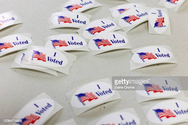 Voting stickers lay on the table at the Fitzgerald Recreation Center on March 10, 2020 in Warren, Michigan. Michigan is one of six states voting in...