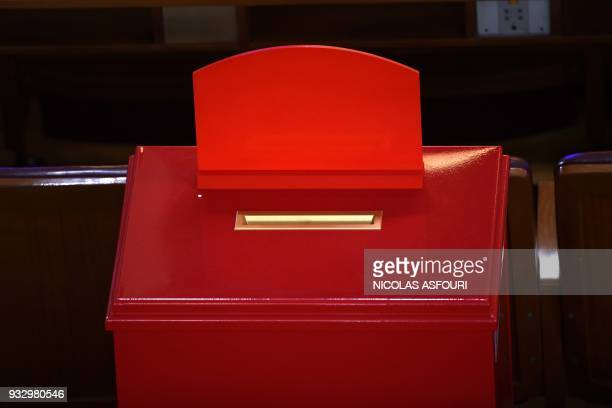 A voting urn stands ahead of the fifth plenary session of the first session of the 13th National People's Congress at the Great Hall of the People in...