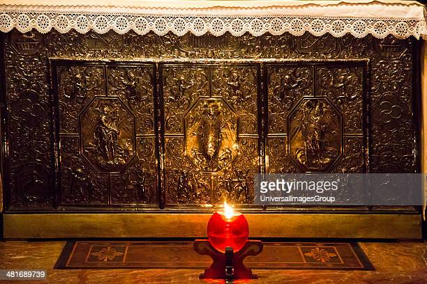Votive candle burning in Duomo Di Milano Milan Lombardy Italy