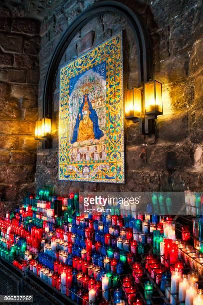 MONTSERRAT CATALUNYA SPAIN Votive candles to an icon of Santa Maria de Montserrat Abbey Monistrol de Montserrat