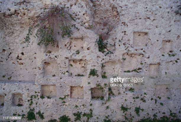 Votive grooves in Via dei Sepolcri, Neapolis Archaeological Park, Syracuse , Sicily, Italy, Magna Graecia civilization, 5th-3rd century BC.