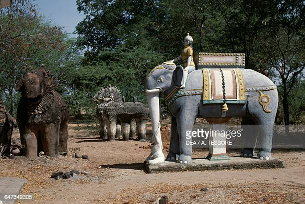 Votive statues of elephants and horses offered to the god Ayanar terracotta Tamil Nadu India