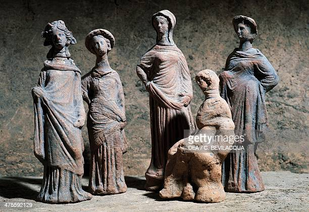 Votive statuettes in terracotta from the area of the Temple of Ceres or Temple of Athena at Paestum Campania Italy Ancient Greek civilisation 5th...