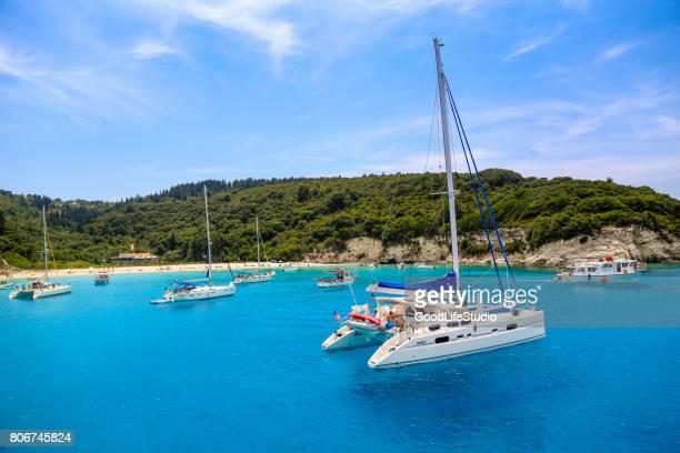 voutoumi beach on antipaxos island - catamaran stock photos and pictures