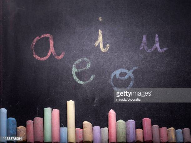 vowels. - chalk art equipment stock pictures, royalty-free photos & images