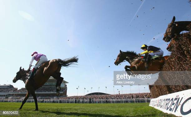Voy Por Ustedes ridden by Robert Thornton clears the last fence to win the John Smith's Melling Steeple Chase during the Grand National meeting held...
