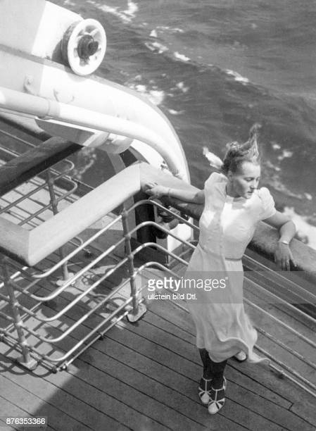 Voyage on a cruise ship or cruise liner travelling female passenger on deck in the wind Erika Schmachtenberger