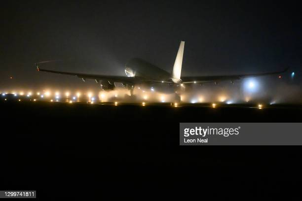 Voyager aircraft carrying a batch of the Covid-19 vaccine takes off into the fog as it begins it's flight to the Falkland Islands from RAF Brize...