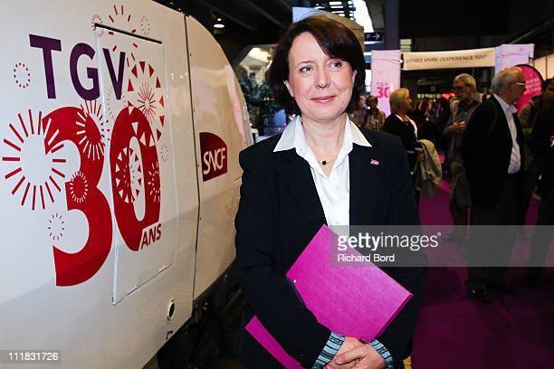 Voyages general manager Barbara Dalibard poses in front of the TGV train during a SNCF presentation at Gare Montparnasse on April 7 2011 in Paris...