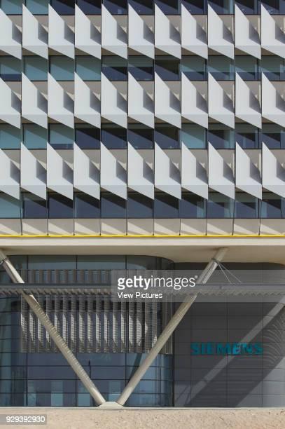Pylons and sun shading system. Siemens Masdar, Abu Dhabi, United Arab Emirates. Architect: Sheppard Robson, 2014.
