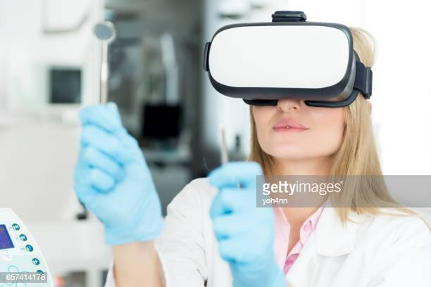 vr headset & medical work tools - stereoscopic images stock photos and pictures