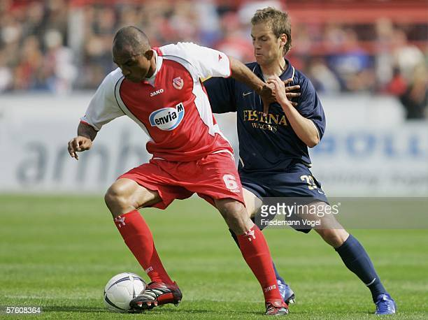 Vragel da Silva of Cottbus challenges for the ball with Patrick Milchraum of 1860 during the Second Bundesliga match between Energie Cottbus and 1860...