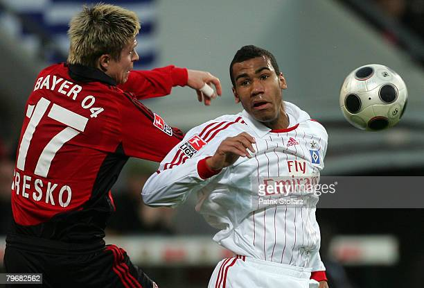 Vratislav Gresko of Leverkusen competes with Moting Choupo of Hamburg during the Bundesliga match between Bayer Leverkusen and Hamburger SV at the...